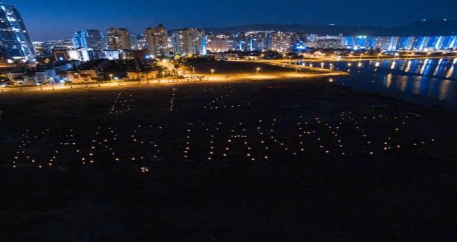 Karşıyaka'da TOKİ'nin satışına mumlu protesto