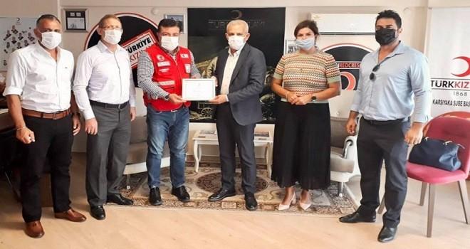 MHP Karşıyaka Yönetimi, Türk Kızılay Karşıyaka Şubesi'ni ziyaret etti